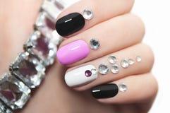 Manicure with rhinestones. Stock Photos