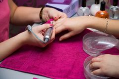 A manicure is in a  salon Stock Photo