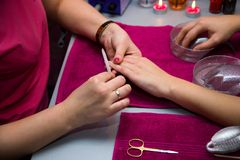 A manicure is in a  salon Royalty Free Stock Images