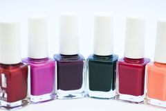 Manicure salon. Gel polish modern technology. Fashion trend. Nail polish bottles. Beauty and care concept. Durability. And quality polish coating. Nail polish stock photography
