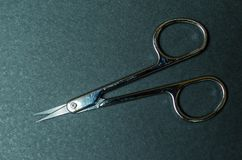 Manicure scissors. For use in a manicure or pedicure.  against a grey background Stock Images