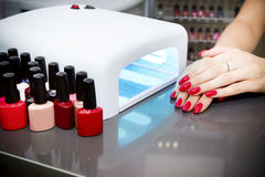 Manicure set. In a beauty salon. Beautiful female hands stock photography
