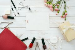 Manicure set and frame red composition of nails tools. top view stock photography