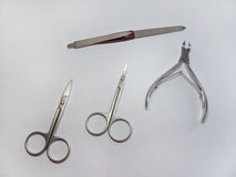 Manicure set: nail Nipper, straight scissors; cuticle scissors (nail scissors bent) and nailfile. Manicure set of several items Royalty Free Stock Photos