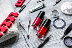 Manicure set and nail polish for hands treatment on wooden background. Manicure set and nail polish for hands treatment on wooden desk background stock photo