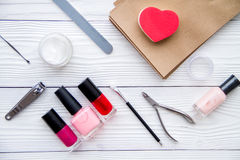 Manicure set and nail polish on wooden background. Top view royalty free stock photos