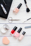 Manicure set and nail polish on wooden background. Top view royalty free stock photography