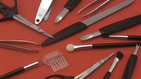 Manicure set on a red  background. stock video footage