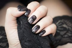 Manicure is similar to black stockings Stock Photos