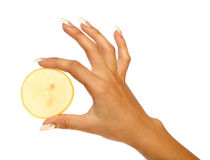 Manicure and sliced orange Royalty Free Stock Photo