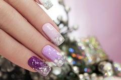 Manicure with snowflakes. Royalty Free Stock Photography