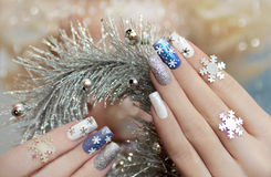 Manicure with snowflakes. Royalty Free Stock Photos