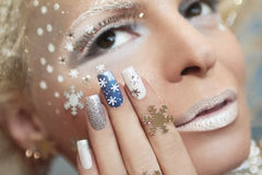 Manicure with snowflakes . Royalty Free Stock Photography