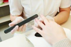 Manicure specialist in beauty salon Stock Photo