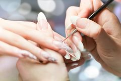 Manicure stage: Painting on the nail Stock Photography