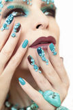 Manicure with stones of turquoise. Stock Images
