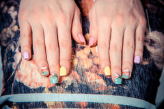 Manicure on the tablecloth of flowers Royalty Free Stock Photos