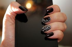 Manicure in the tone of a smartphone with interesting highlights Stock Photography
