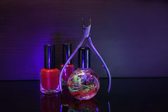 Manicure tool and red nail polish bottle with cuticle oil  on bl. Ack  background isolend Royalty Free Stock Photos