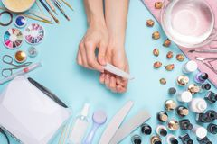 Manicure - tools for creating, gel polishes, care and hygiene for nails. Beauty salon, nail salon, mastira for working with nochts. Blue background stock photos