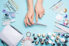 Manicure - tools for creating, gel polishes, care and hygiene for nails. Beauty salon, nail salon, mastira for working with nochts. Women`s love for hands royalty free stock photography