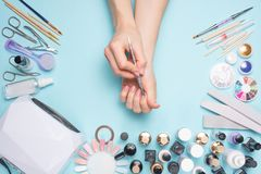 Manicure - tools for creating, gel polishes, care and hygiene for nails. Beauty salon, nail salon, mastira for working with nochts. Women`s love for hands royalty free stock images