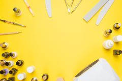Manicure - tools for creating, gel polishes, everything for nail care, beauty and care concept. Banner for inscriptions salon. Yellow background Flat-lay royalty free stock images