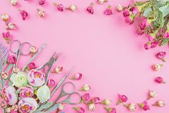 Manicure tools on a pink background decorated with flowers. stock images