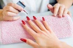 Manicure treatment. At beauty salon close-up Stock Photography