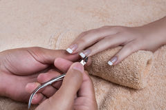 Manicure. Trimming the cuticle Stock Image