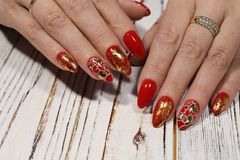 Manicure for Valentine& x27;s Day. Red with gold and heart stock images