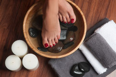Manicured female feet in spa pedicure procedure Royalty Free Stock Image