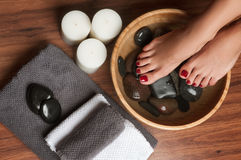 Manicured female feet in spa pedicure procedure Stock Photography
