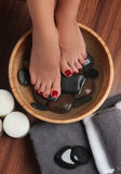 Manicured female feet in spa pedicure procedure Stock Photo