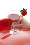 Manicured female hand holding red cocktail drink Royalty Free Stock Photo