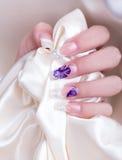 Manicured female hand. Studio shot Stock Photo