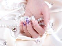 Manicured female hand. Studio shot Stock Photos