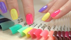 Manicured finger nails and nail samples. stock video
