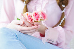 Manicured fingernails and rose flowers Royalty Free Stock Photos