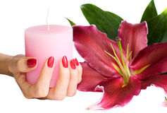 Manicured hand holding a candle Royalty Free Stock Photos