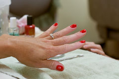 Manicured hand with red fingernail polish Royalty Free Stock Photography