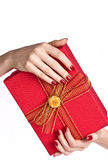 Manicured hands holding present box Royalty Free Stock Photography