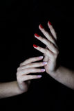 Manicured hands with nailpolish Stock Photography