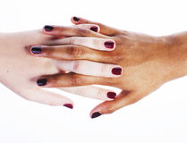 Manicured hands on white isolated, african with caucasian close up, connection diverse people concept Stock Images