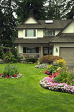 Manicured Home and Garden. A well kept home with a colourful perennial and annual garden Royalty Free Stock Photo