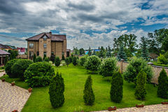 Manicured House and Garden Royalty Free Stock Image