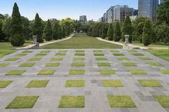 Manicured Lawns, The Shrine of Remembrance, Melbourne, Australia. A view of the checked grass and concrete squares leading to the manicured lawns at the rear of Stock Photos