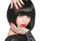 Manicured nails. Beauty girl portrait. Red lips. Back short bob