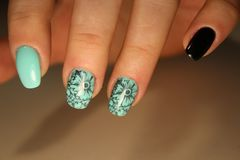 Manicured nails Nail Polish art design. Royalty Free Stock Image