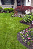 Manicured Spring Yard. Spring garden planted and ready for warmer weather Stock Image